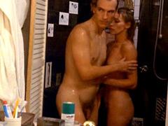 Fully naked Joanna Pacula looks at a hairy penis