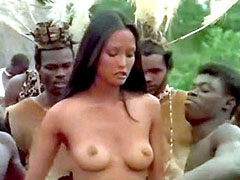 Fully naked Laura Gemser sucks dick