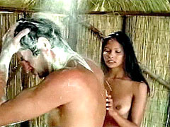 Nude Laura Gemser sucks big dick