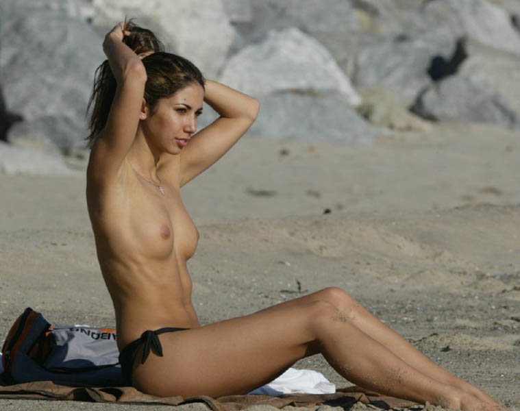 Glamour model Leilani Dowding topless on a margin