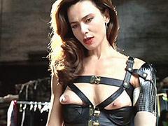 Lena Olin in sexi bondage outfit..