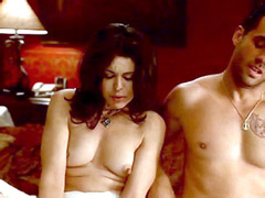 Maria Conchita Alonso sitting topless on bed and talking..