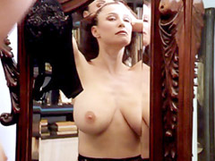 Busty actress Mimi Rogers fully undresses before a mirror