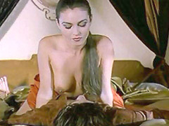 Monica Bellucci giving us nice view of her breasts as she rides guy in bed