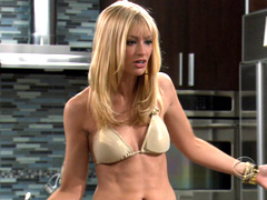Beth Behrs gets wet with her top off