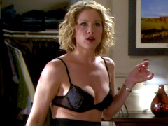 Christina Applegate shows hints of tit nude under an apron