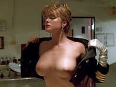 Erika Eleniak shows off her huge,..