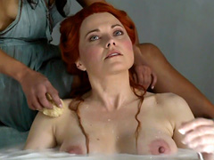 Lucy Lawless shows her moist mammaries while soaking in the bathtub