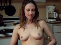 Vera Farmiga exposes her cute tits while reading at the kitchen table