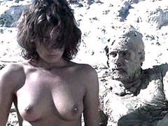 Naked Paz Vega with naked guys on beach