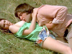 Peggy Church lying on grass while guy..