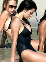 Penelope Cruz in bikini sunbathing with..