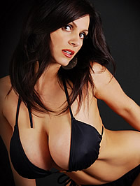 Denise Milani showing her huge boobs in..