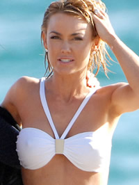 Kelly Carlson hard nipples in white..
