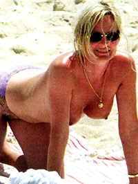 Jennifer Jason Leigh caught topless on..