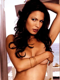 Nadine Velazquez topless with hand on..