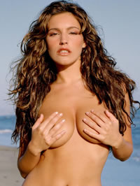 Kelly Brook nude and bikini beach shots