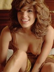 Eva Mendes poses unadorned with an..