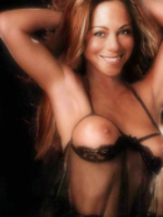 Sexy pop artist Mariah Carey showing..