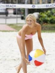 Stephanie Patt in a bikini playing..
