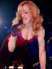 Madonna sings in sexy outfit and shown..
