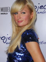 Hot blonde Paris Hilton wears XXX dress..