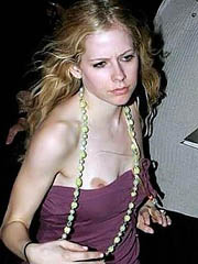 Avril Lavigne oops flashes off boob slip