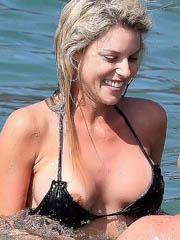 Carrie Prejean oops boob slip in a bikini