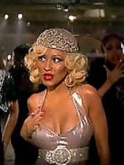 Christina Aguilera flashes big cleavage..