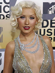 Christina Aguilera flashes off cleavage