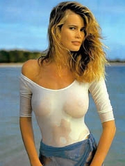 Claudia Schiffer caught topless on the..