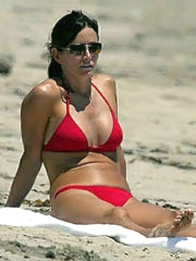 Courtney Cox hot milf body in a red..