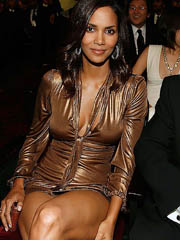 Halle Berry flashes big cleavage and..