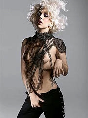 Lassie Gaga topless strips down be..