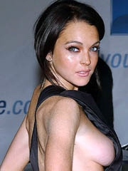 Lindsay Lohan oops big boob pop out..