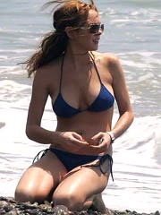 Lindsay Lohan big boobs in a blue bikini