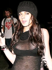 Lindsay Lohan flashes sideboob cleavage