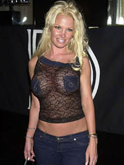 Pamela Anderson flashes off boob slip