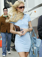 Paris Hilton braless flashes hard nipples