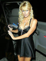 Paris Hilton cleavage in short black..