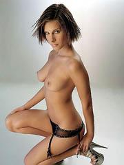 Rebekah Teasdale posing topless and in..
