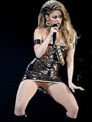 Shakira flashes upskirt to the fullest..
