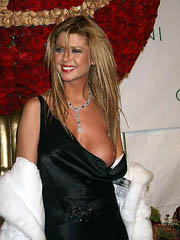 Tara Reid oops flashes elsewhere boob..