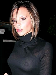 Victoria Beckham flashes pushed up..
