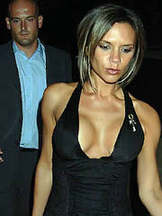 Victoria Beckham oops flashes boob slip