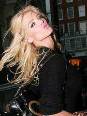 Victoria Silvstedt leggy in short black..