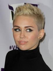 Miley Cyrus in a tight revealing black..
