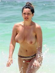 Heavy-chested Kelly Brook topless..