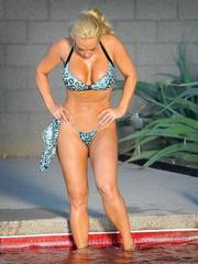 Busty Coco Austin squeezes into a tiny..