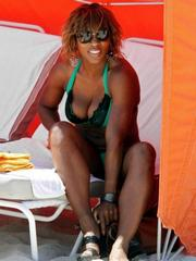 Serena Williams posing in her green..